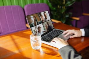 man-using-laptop-videocall-while-drinking-water_Easy-Resize.com
